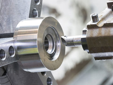 A CNC lathe cutting tool machining a workpiece - part of Glassworks' precision CNC machining services