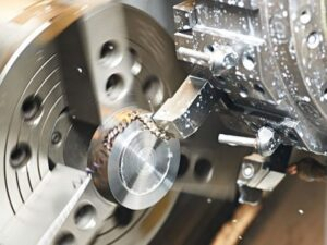 a CNC lathe cutting tool cutting a workpiece - one of Glassworks' precision engineering services